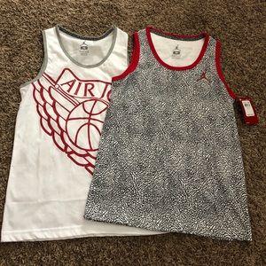 2 Brand new Jordan sleeveless shirts.
